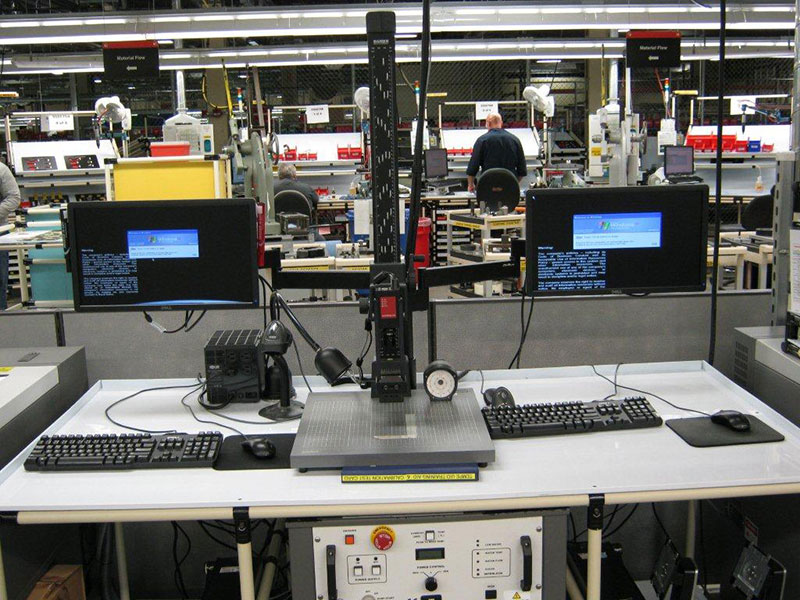 industrial dual articulating arm mount for computer monitor in factory